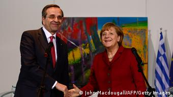 Greece's Prime Minister Antonis Samaras (L) and Germany's Chancellor Angela Merkel address a press conference on January 8, 2013 at the Chancellery in Berlin, Germany. Merkel holds talks with Samaras, who is attending a closed-door economics conference in Berlin. AFP PHOTO / JOHN MACDOUGALL (Photo credit should read JOHN MACDOUGALL/AFP/Getty Images)