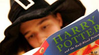 A boy reads a Harry Potter book
