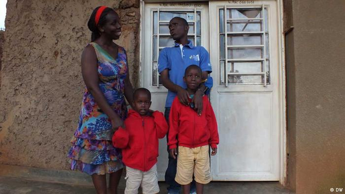 The pictures shows the blind couple, Jean-Pierre Munyankiko and Venancie Mukanziza with their two children. The picture is taken in front of their house in Kigali. ------ Photo: Sylivanus Karemera, Dezember 2012