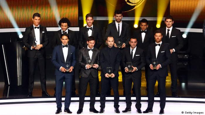 ZURICH, SWITZERLAND - JANUARY 07: Real Madrid's Portuguese forward Cristiano Ronaldo, Real Madrid's Marcello, Real Madrid's Sergio Ramos, Barcelona's Gerard Pique, Barcelona's Dani Alves, Real Madrid's Iker Casillas (Bottom L-R) Atletico Madrid's Colombian forward Radamel Falcao, Barcelona's Argentinian forward Lionel Messi, Barcelona's Spanish midfielder Andres Iniesta, Barcelona's Xavi Hernandez and Real Madrid's Xabi Alonso receive the FIFA/FIFPro World XI award during the FIFA Ballon d'Or awards ceremony at the Kongresshaus in Zurich on January 7, 2013. (Photo by Christof Koepsel/Getty Images)