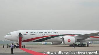 A Boeing 777-300ER aircraft which was delivered to Biman Bangladesh Airlines Wednesday is seen at the Shahjalal International Airport in Dhaka. Biman is also buying Boeing 787 planes.