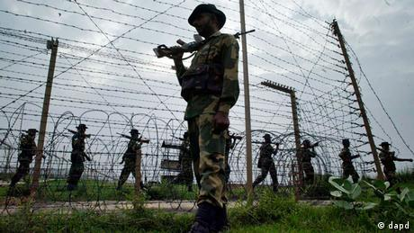 Border Security Force soldiers patrol the India-Pakistan border at Kanachak, about 15 kilometers (9 miles) west of Jammu, India