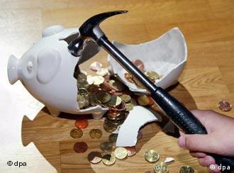 A hammer smashing a piggy bank