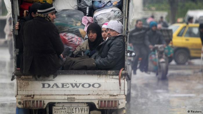 Civilians fleeing from the violence are pictured with their belongings on a vehicle in Aleppo in this January 5, 2013 file photo. As government forces fight on in parts of Aleppo, in large areas that have been under rebel control for six months or more complaints are getting louder about indiscipline among the fighters, looting and a general lack of security and necessities like running water, bread and electricity to areas that have been pounded by tanks and hit by Syria's President Bashar al-Assad's air strikes. To match Insight SYRIA-CRISIS/REBELS REUTERS/Muzaffar Salman/Files (SYRIA - Tags: CONFLICT CIVIL UNREST)