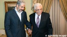 A hand out picture provided by the Hamas press office shows Palestinian president Mahmud Abbas (R) meeting with the exiled leader of the Palestinian Islamist movement Hamas, Khaled Meshaal (L) in Cairo on December 21, 2011. Palestinian factions, led by the former rivals Hamas and Fatah meeting in Cairo are mulling ways to reactivate their national parliament, which has been paralysed since 2007 following the split between the West Bank and Gaza. AFP PHOTO/RESTRICTED TO EDITORIAL USE - MANDATORY CREDIT 'AFP PHOTO /HAMAS PRESS OFFICE /MOHAMMED AL-HAMS ' - NO MARKETING NO ADVERTISING CAMPAIGNS - DISTRIBUTED AS A SERVICE TO CLIENTS (Photo credit should read - -/AFP/Getty Images)