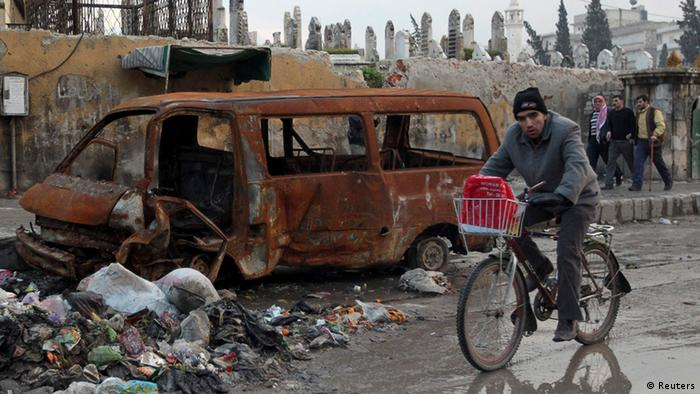 A man rides his bicycle in Aleppo city January 9, 2013. (Photo: Muzaffar Salman/REUTERS)