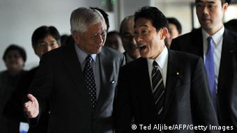 Philippine Affaris Secretary Albert del Rosario (L) shows the way to his Japanese counterpart Fumio Kishida (front R) (TED ALJIBE/AFP/Getty Images)