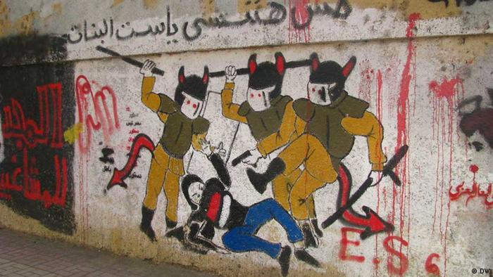 Graffiti showing soldiers who rip the clothes of one female protestor (Photo: Nael Eltoukhy)