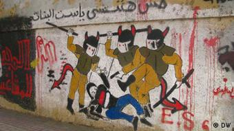 photo title: we will not forget photo description: we will not forget, a graffiti about the soldiers who takes the clothes of one female protestor photo date: 8 -1- 2013 photo place: Cairo, Egypt copy rights: Nael Eltoukhy