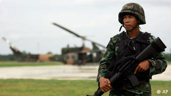 A Thai soldier stands while providing security to small group of visiting journalists at an army base in Pattani province, southern Thailand (AP Photo/Apichart Weerawong)