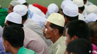 Thai Muslim men, (AP Photo/Apichart Weerawong)