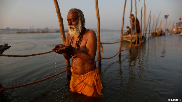 A Hindu devotee prays before taking a dip in the waters of the holy Ganges river ahead of the Kumbh Mela (Pitcher Festival) in the northern Indian city of Allahabad January 11, 2013. During the festival, Hindus take part in a religious gathering on the banks of the river Ganges. Kumbh Mela will return to Allahabad in 12 years. REUTERS/Ahmad Masood (INDIA - Tags: RELIGION TPX IMAGES OF THE DAY)