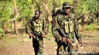 Ugandan soldiers on patrol during an operation to fish out Joseph Kony in the Central African jungle. Photo: STRINGER/AFP/Getty Images)
