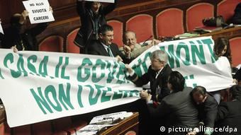 Lawmakers of the Lega Nord party hold a banner to protest a law proposal at the Senate hall in Rome, Italy, 21 December 2012. EPA/GIUSEPPE LAMI pixel