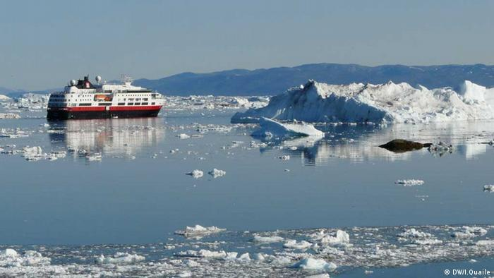 Greenland, ship in melting ice.