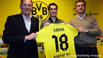 DORTMUND, GERMANY - JANUARY 11: New player Nuri Sahin poses with chairman Hans Joachim Watzke and manager Michael Zorc during a Borussia Dortmund press conference at Signal Iduna Park on January 11, 2013 in Dortmund, Germany. (Photo by Lars Baron/Bongarts/Getty Images)