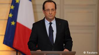 France's President Francois Hollande delivers a statment on the situation in Mali at the Elysee Palace in Paris, January 11, 2013. France's President Hollande confirmed that French armed forces began an intervention today to support Malian government forces. REUTERS/Philippe Wojazer (FRANCE - Tags: POLITICS TPX IMAGES OF THE DAY)