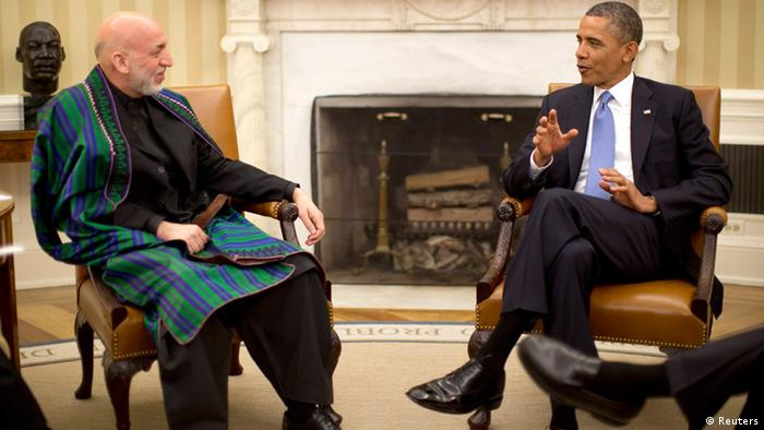 U.S. President Barack Obama meets with Afghanistan's President Hamid Karzai in the Oval Office of the White House in Washington, January 11, 2013. REUTERS/Jason Reed (UNITED STATES - Tags: POLITICS MILITARY)