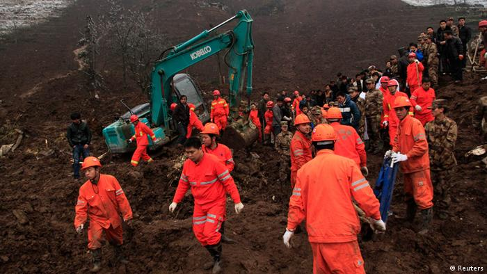 Rescuers search for survivors after a landslide hit Zhenxiong county, Yunnan province January 11, 2013. The death toll from a landslide that hit a mountainous region in southwest China's Yunnan Province on Friday has risen to 42, after more bodies were retrieved, Xinhua News Agency reported. REUTERS/China Daily (CHINA - Tags: DISASTER ENVIRONMENT) CHINA OUT. NO COMMERCIAL OR EDITORIAL SALES IN CHINA