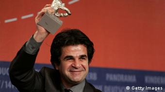 Iranian film director Jafar Panahi holds his Jury Grand Priz Silver Bear Award for 'Offside' at the Berlin International Film Festival 2006