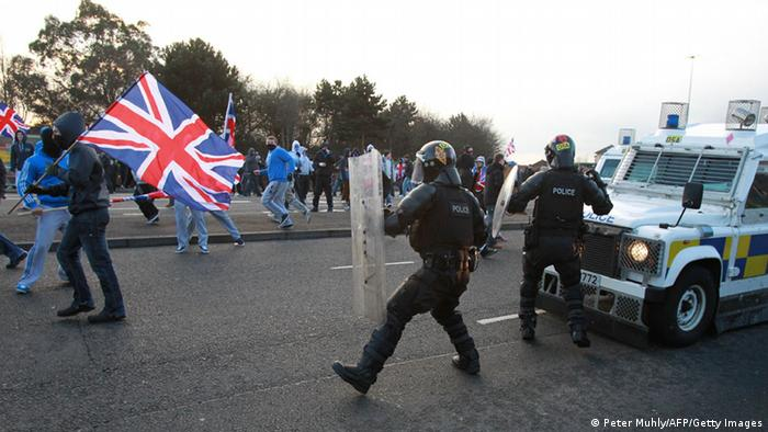Loyalist protesters clash with police in east Belfast, Northern Ireland (Photo PETER MUHLY/AFP/Getty Images)