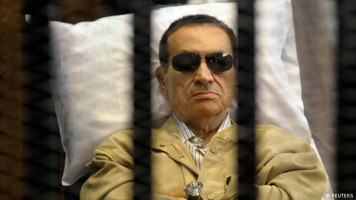 Former Egyptian President Hosni Mubarak sits inside a cage in a courtroom in Cairo in this June 2, 2012 file photo. Egypt's Appeals Court accepted an appeal by Mubarak and his former interior minister on January 13, 2013, allowing him to be retried over the killing of protesters in the 2011 uprising. REUTERS/Stringer/Files (EGYPT - Tags: POLITICS CRIME LAW)