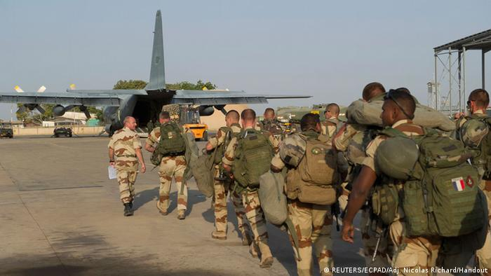 French troops prepare to board a transport plane in N'Djamena, Chad, in this photo released by the French Army Communications Audiovisual office (ECPAD) on January 12, 2013. French forces carried out a second day of air strikes against Islamist rebels in Mali on Saturday and sent troops to protect the capital Bamako in an operation involving several hundred soldiers, Defence Minister Jean-Yves Le Drian said. REUTERS/ECPAD/Adj. Nicolas Richard/Handout (CHAD - Tags: POLITICS MILITARY) NO SALES. NO ARCHIVES. ATTENTION EDITORS - THIS IMAGE WAS PROVIDED BY A THIRD PARTY. FOR EDITORIAL USE ONLY. NOT FOR SALE FOR MARKETING OR ADVERTISING CAMPAIGNS. THIS PICTURE IS DISTRIBUTED EXACTLY AS RECEIVED BY REUTERS, AS A SERVICE TO CLIENTS