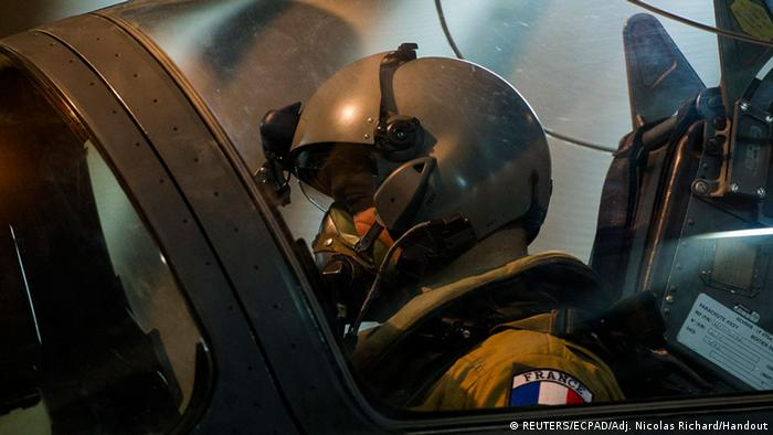 A French pilot in the cockpit of a Mirage 2000D fighter plane gets ready for take-off from N'Djamena, Chad in this photo released by the French Army Communications Audiovisual office (ECPAD) on January 12, 2013.French forces carried out a second day of air strikes against Islamist rebels in Mali on Saturday and sent troops to protect the capital Bamako in an operation involving several hundred soldiers, Defence Minister Jean-Yves Le Drian said. REUTERS/ECPAD/Adj. Nicolas Richard/Handout (CHAD - Tags: POLITICS MILITARY) NO SALES. NO ARCHIVES. ATTENTION EDITORS - THIS IMAGE WAS PROVIDED BY A THIRD PARTY. FOR EDITORIAL USE ONLY. NOT FOR SALE FOR MARKETING OR ADVERTISING CAMPAIGNS. THIS PICTURE IS DISTRIBUTED EXACTLY AS RECEIVED BY REUTERS, AS A SERVICE TO CLIENTS