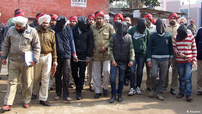 Six men with their faces covered, accused of a gang rape in Punjab (Photo: REUTERS/Stringer)
