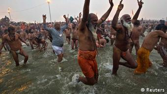 Sadhus or Hindu holymen attend the first 'Shahi Snan' (grand bath) at the ongoing Kumbh Mela, or Pitcher Festival, in the northern Indian city of Allahabad January 14, 2013 (Photo: REUTERS/Ahmad Masood)