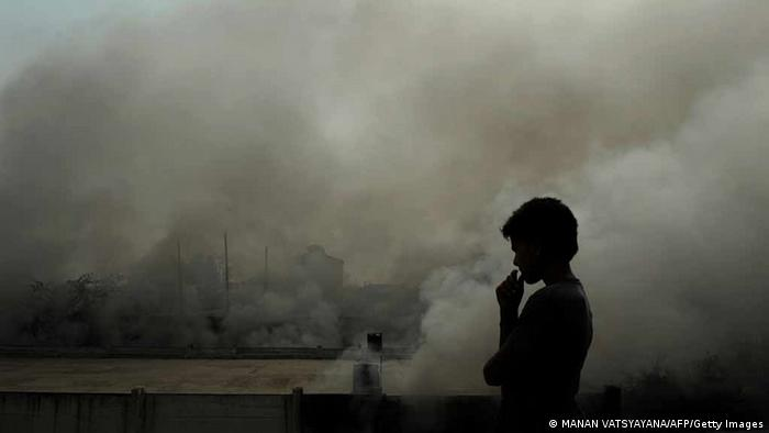 An Indian boy watches smoke rise from a warehouse in New Delhi on May 5, 2010. No casualties were reported in the fire. AFP PHOTO/ MANAN VATSYAYANA (Photo credit should read MANAN VATSYAYANA/AFP/Getty Images)