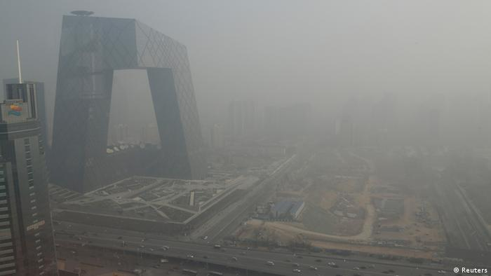 The China Central Television (CCTV) building is seen next to a construction site in heavy haze in Beijing's central business district, January 14, 2013. (Photo: Reuters)
