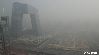 The China Central Television (CCTV) building is seen next to a construction site in heavy haze in Beijing's central business district, January 14, 2013. In an unusual display of unity in criticising a troubling domestic social problem, Chinese media are giving prominent coverage to the historically high level of air pollution that has choked wide swaths of the country for the past few days. Air quality in Beijing was far above hazardous levels over the weekend, reaching 755 or higher, according to an index known as PM2.5. The World Health Organisation recommends a daily level of no more than 20 for PM2.5, which measures particulate matter with a diameter of 2.5 micrometers. REUTERS/Jason Lee (CHINA - Tags: ENVIRONMENT BUSINESS MEDIA)