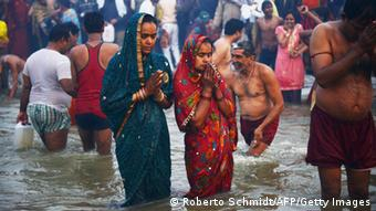Hindu devotees pray AFP PHOTO/ ROBERTO SCHMIDT (Photo credit should read ROBERTO SCHMIDT/AFP/Getty Images)