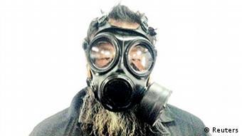 Ai Weiwei mit Maske (Protest Luftverschmutzung). Bild geliefert von DW/Shenjun Liu: Meine Kollegin Su Yutong hat Copyright dafür und ist einverstanden, dass wir es benutzen dürfen!