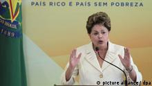 Brazil's President, Dilma Rousseff during the announcement ceremony of the Growth Acceleration Program (PAC) to increase about 3.300 million dollars the amount of government purchases in order to mitigate the effects of international financial crisis on the Brazilian economy, June 27, 2012. Photo: Joedson Alves/dpa/apm
