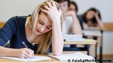 Student working on homework in classroom © Moritz Wussow #28634921