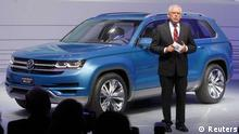 Dr. Ulrich Hackenberg, Member of the Board, Volkswagen Brand, speaks next to the 2014 Touran Cross Blue at the North American International Auto Show in Detroit, Michigan January 14, 2013. REUTERS/Rebecca Cook (UNITED STATES - Tags: TRANSPORT BUSINESS)