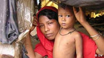 A Rohingya mother and her child in a makeshift camp in Teknaf