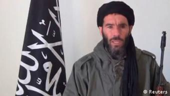 Mokhtar Belmokhtar, identified by the Algerian interior ministry as the leader of a militant Islamic group, is pictured in a screen capture from an undated video distributed by the Belmokhtar Brigade obtained by Reuters January 16, 2013. Belmokhtar, an Algerian who fought against Soviet forces in Afghanistan in the 1980's, has claimed responsibility for the January 16 kidnapping of up to 41 foreigners at an Algerian gas field, according to media reports. REUTERS/Belmokhtar Brigade/Handout (ALGERIA - Tags: POLITICS CRIME LAW TPX IMAGES OF THE DAY) NO SALES. NO ARCHIVES. ATTENTION EDITORS - THIS PICTURE WAS PROVIDED BY A THIRD PARTY. REUTERS IS UNABLE TO INDEPENDENTLY VERIFY THE AUTHENTICITY, CONTENT, LOCATION OR DATE OF THIS IMAGE. FOR EDITORIAL USE ONLY. NOT FOR SALE FOR MARKETING OR ADVERTISING CAMPAIGNS. THIS PICTURE IS DISTRIBUTED EXACTLY AS RECEIVED BY REUTERS, AS A SERVICE TO CLIENTS