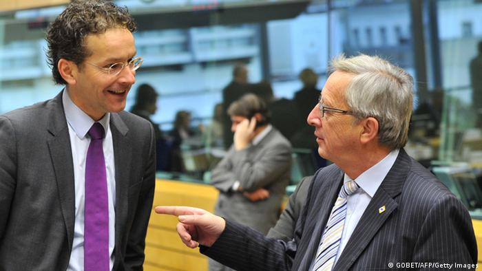 Dutch Finance Minister Jeroen Dijsselbloem chatting with Luxembourg's Prime Minister Jean-Claude Juncker AFP PHOTO / GEORGES GOBET (Photo credit should read GEORGES GOBET/AFP/Getty Images)
