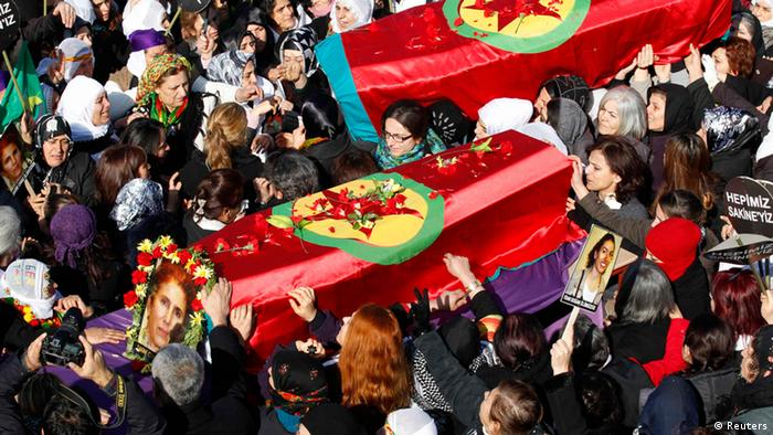 People carry the coffins of the Kurdish activists who were shot in Paris, during a funeral ceremony in Diyarbakir, the largest city in Turkey's mainly Kurdish southeast, January 17, 2013.REUTERS/Umit Bektas