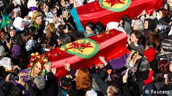 People carry the coffins of the Kurdish activists who were shot in Paris REUTERS/Umit Bektas