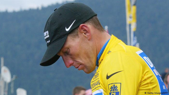 Gerardmer, FRANCE: (FILES) US Lance Armstrong (Discovery Channel/USA) leaves the podium after retaining the yellow jersey as overall leader at the end of the eighth stage of the 92nd Tour de France cycling race between Pforzheim and Gerardmer, 09 July 2005. SEBASTIEN BERDA/AFP/Getty Images