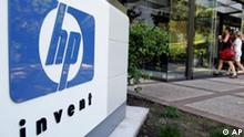 Hewlett Packard Company workers enter HP headquarters in Palo Alto, Calif., Friday morning, July 15, 2005. Hewlett-Packard Co. is expected to cut thousands of jobs next week as part of a long-expected restructuring that will attempt to bring the computer maker's costs in line with business and its rivals' numbers, according to industry analysts. (AP Photo/Paul Sakuma)