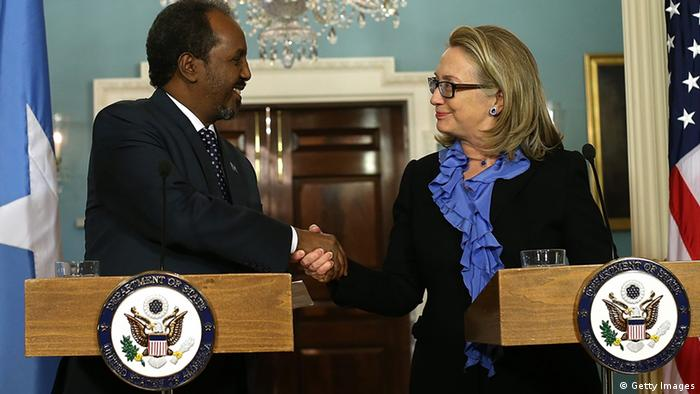 WASHINGTON, DC - JANUARY 17: Secretary of State Hillary Clinton (R) shakes hands with Somali president Hassan Sheikh Mohamud during a news conference on January 17, 2013 in Washington, DC. Secretary Clinton announced that the United States would recognize the Somali government for the first time in over 20 years, since the shooting down in Mogadishu of two American Black Hawk helicopters. (Photo by Justin Sullivan/Getty Images)