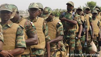 Men in military uniforms lined up. (Photo Ange Obafemi /Panapress)