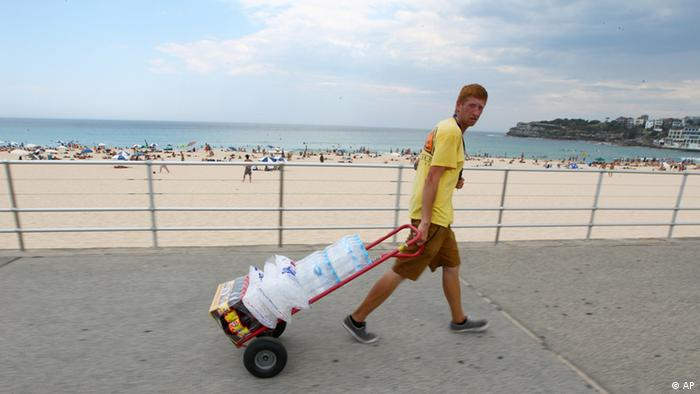 Stocking up on water to keep dehydration at bay during the deadly heat. Photo credit: AP.