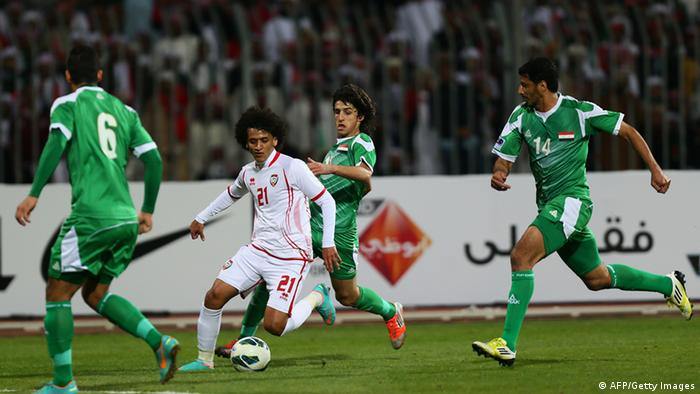 Emirati player Omar Abdul Rahman (C) dribbles past Humam Tariq Faraj ( back) Salam Shaker (R) and Ali Adnan al-Tameemi of Iraq during their 21st Gulf Cup football match final in Manama, on January 18, 2013. AFP PHOTO/MARWAN NAAMANI (Photo credit should read MARWAN NAAMANI/AFP/Getty Images)