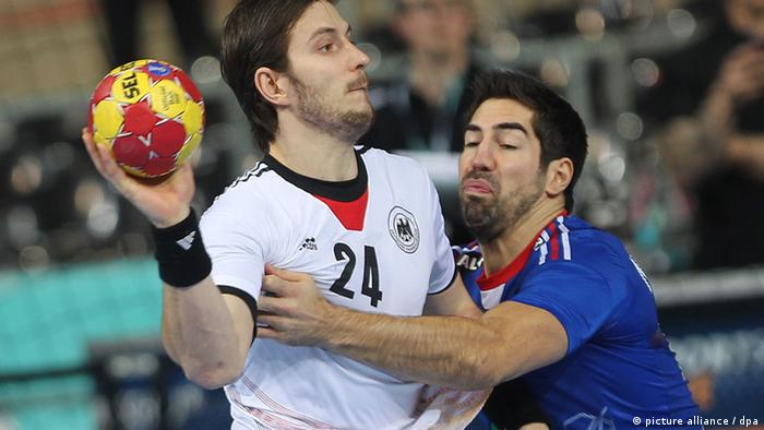 Michael Haass (L) of Germany is blocked by Nikola Karabatic (R) of France during the men's Handball World Championships main round match Germany vs France in Barcelona, Spain, 18 January 2013. (Photo: Fabian Stratenschulte/dpa)